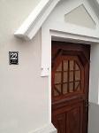 Die historische Nebeneingangstür ist saniert_1